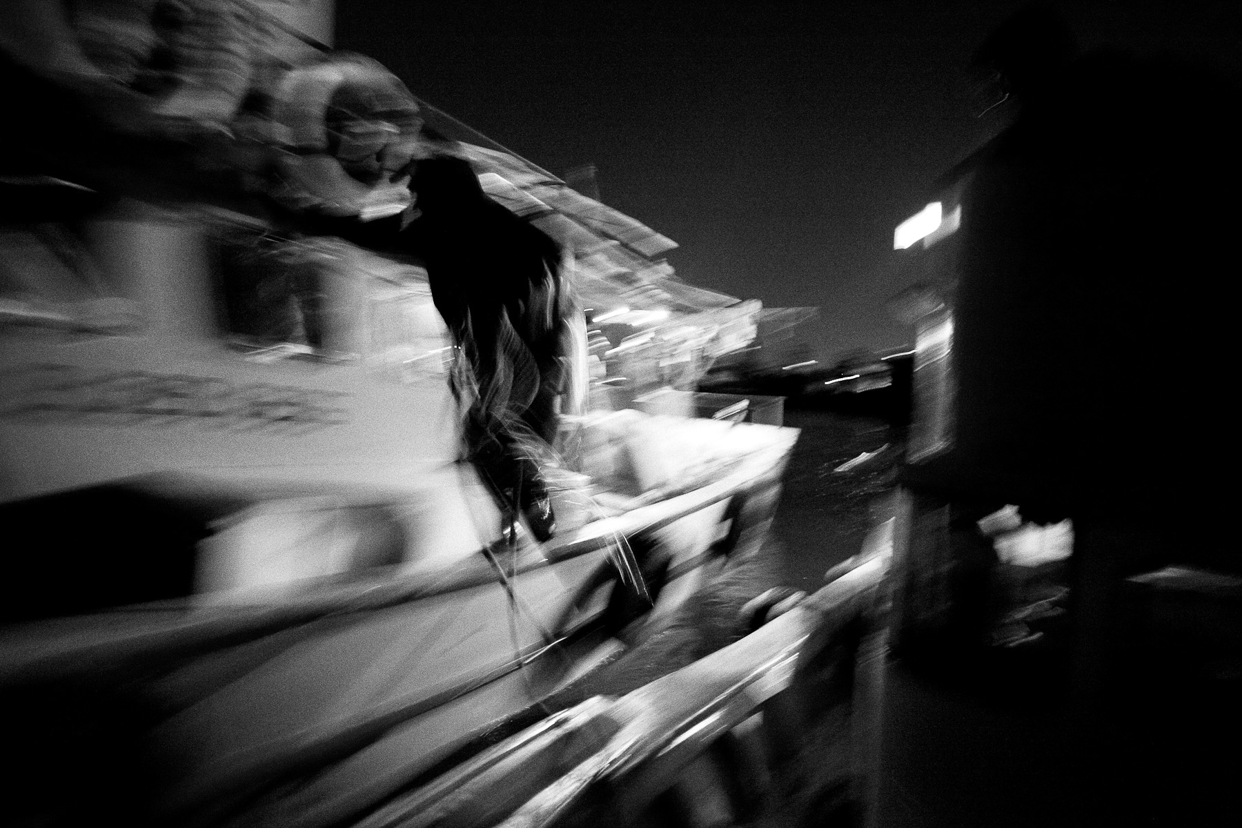 A fisherman jumps onto a friend's boat to tie them together as they stop to help each other with sorting the fish on the Marmara sea off the coast of Istanbul on 22nd June 2010.