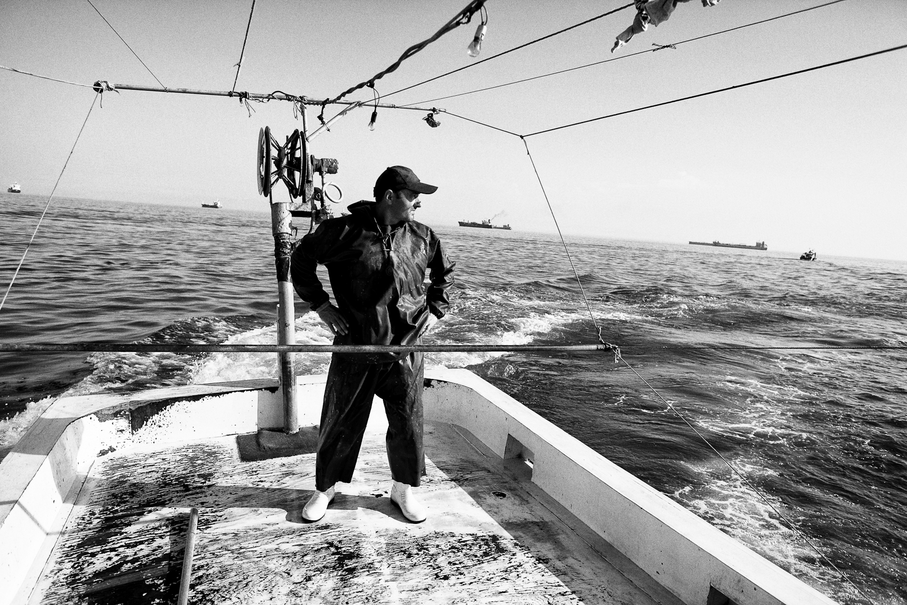 Cinar observes the sea as they circle the schools of fish in the Marmara Sea on June 21, 2010.