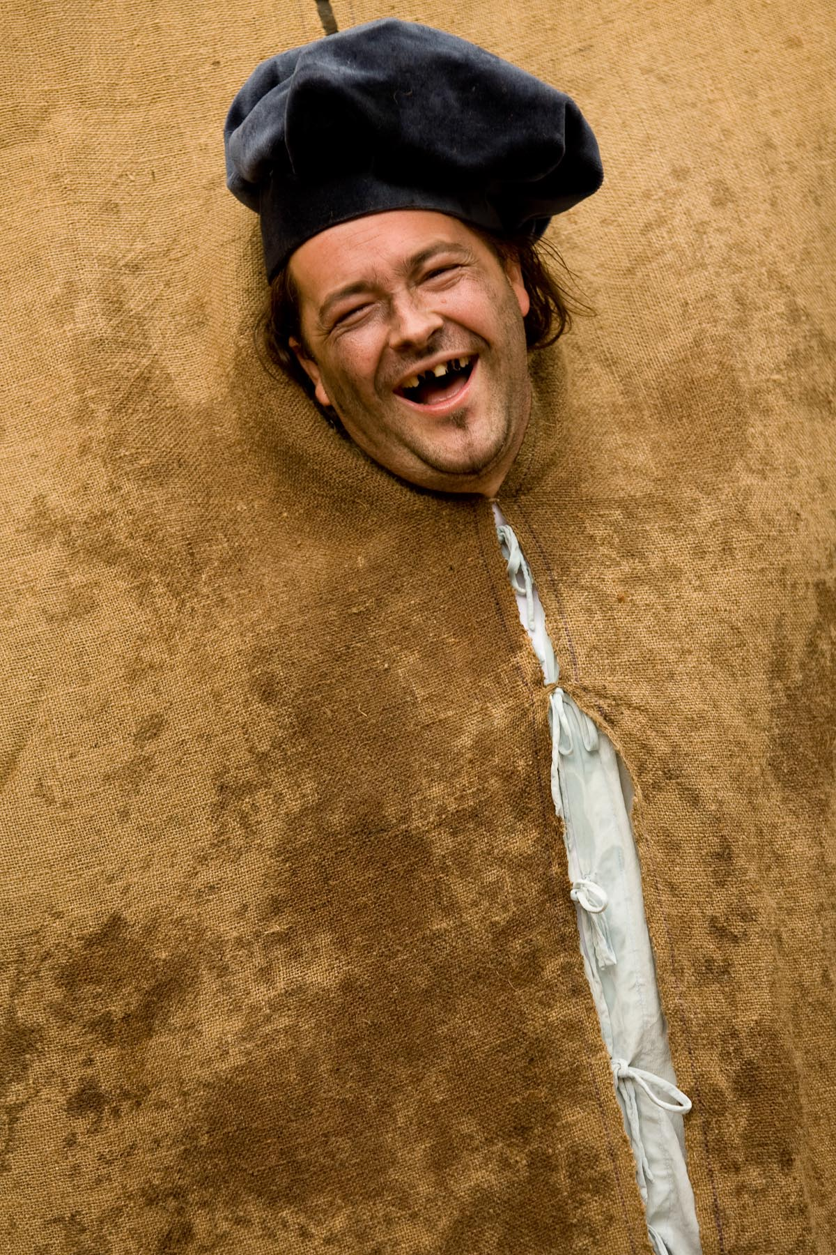 A buffoon participates in a play where people must hit his face with a wet sponge in Skofja Loka, Slovenia, on June 23, 2007.