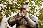 A knight takes a picture with a cell phone at the Ljubljana castle on September 9, 2007. Hiding signs of present day is extremely difficult when our culture is so dependant on technology and basic modern inventions. Cell phones are forbidden for all event participants, but it is impossible to control the large numbers of performers.