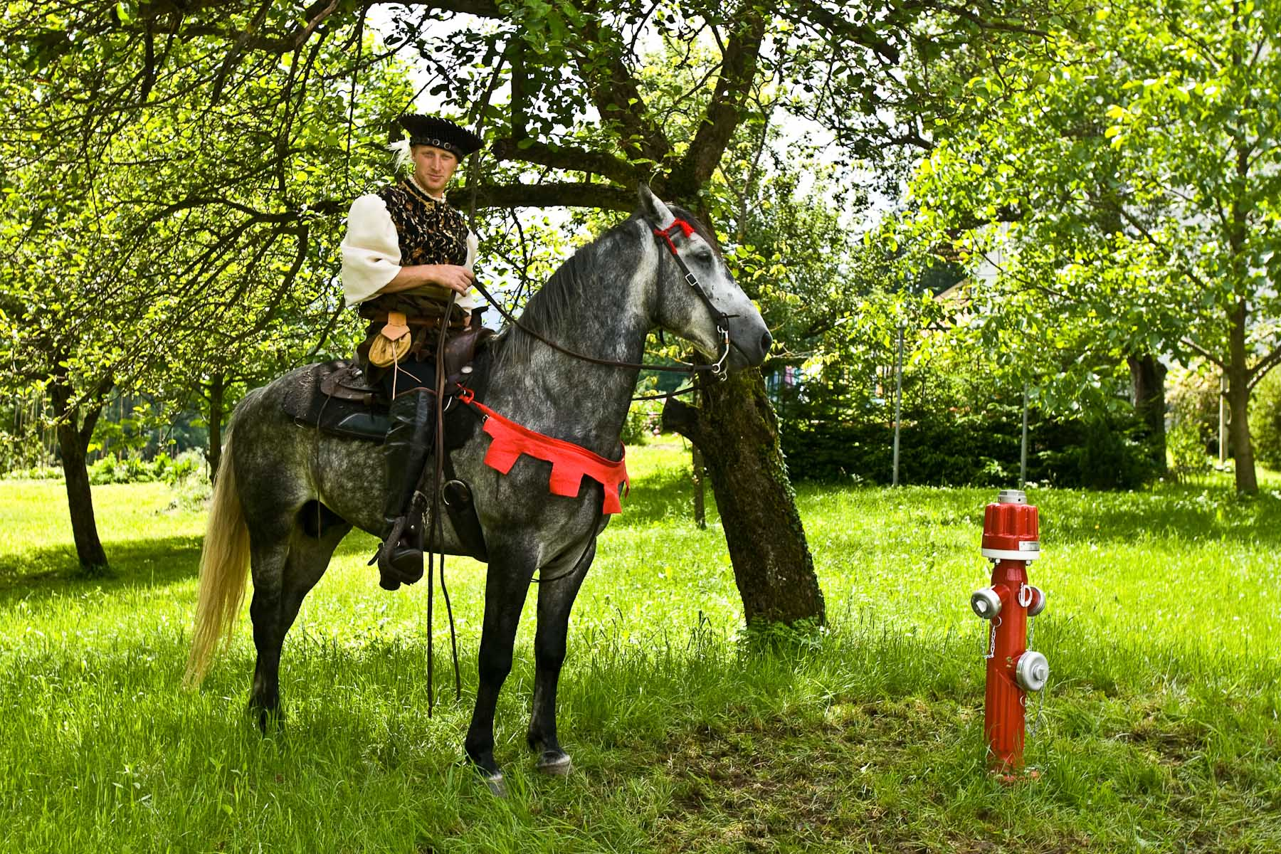 A knight and his horse wait by a fire hydrant in Bled, Slovenia, on June 8, 2008. Signs of modern era are everywhere and are inavoidable. To cover it all would need too much funding, an expense Slovenian organizers cannot afford. But Austrians do. In Friesach they actually cover hydrants etc. and turn off electricity.