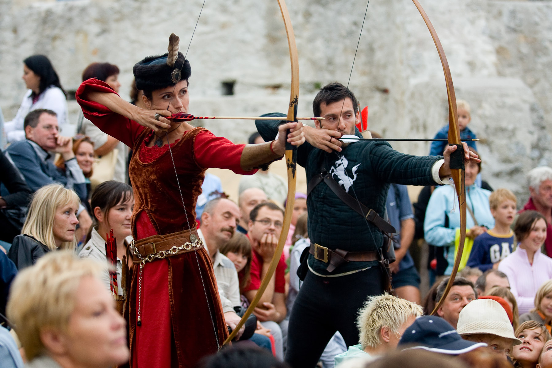 Archers perform at the castle of Celje, Slovenia, on August 30, 2008. Archery is an essential part of Medieval events. Target shooting is performed by skillful knights, while at the same time recreational target shooting is organized for visitors.