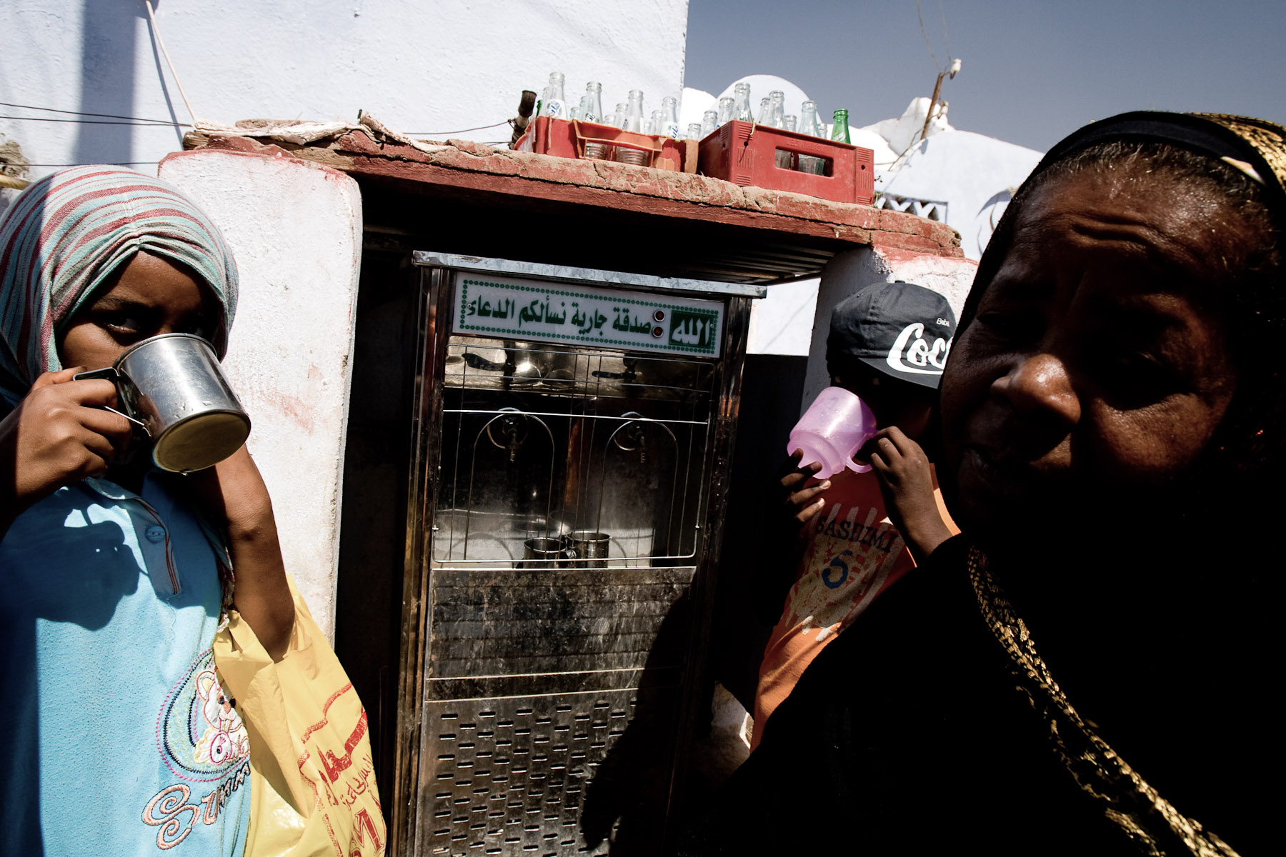 Nubian women drink water from a government funded machine in the Nubian village in Aswan, Egypt, on May 1, 2008.