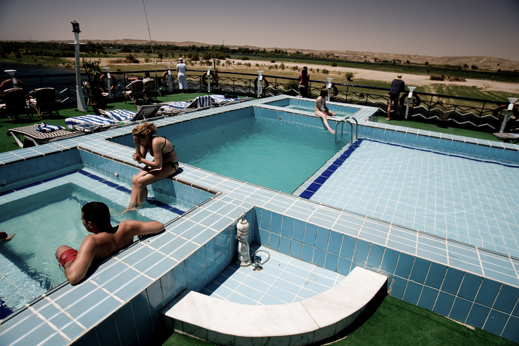 Tourists bathe in a pool on one of many cruiseships on the Nile on April 30, 2008. Ironically, the Nile is more or less too polluted to bathe in it safely.