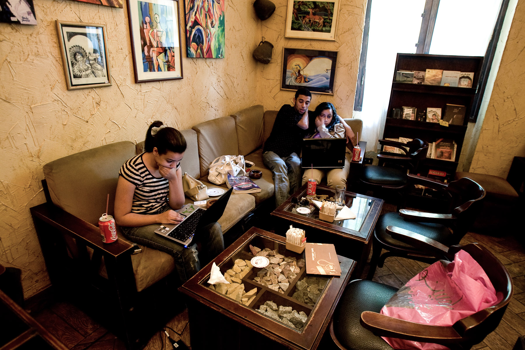 The young surf the internet and drink Coca Cola in a caffe in Cairo, Egypt.