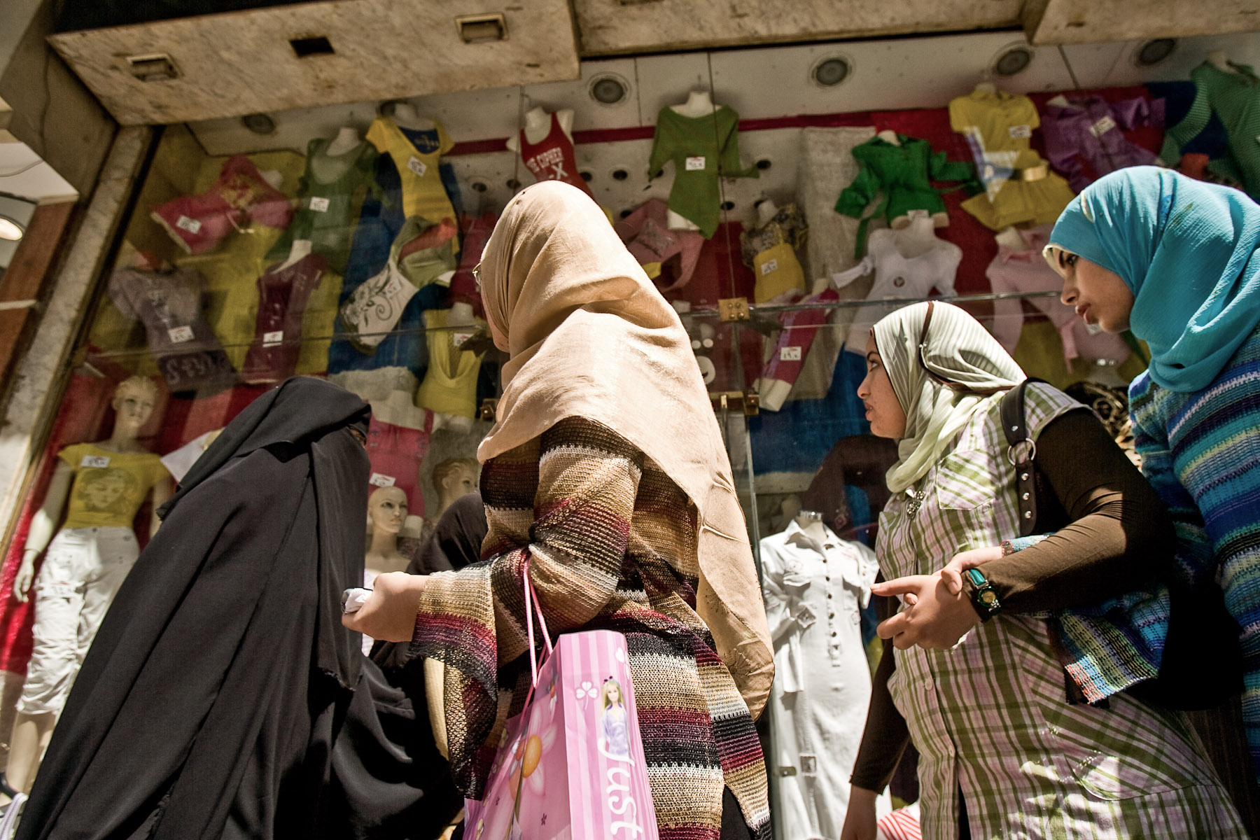 Women look at a shop window in Cairo, Egypt, May 3, 2008.