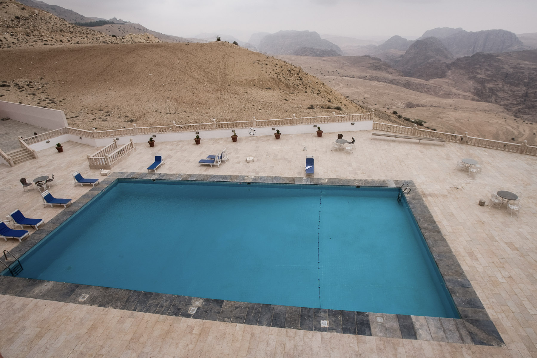 An empty hotel pool stands out of the desert mountains surrounding Petra, Jordan, on May 1, 2009.