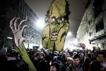 Protesters carry a zombie cardboard cutout during a protest staged by cultural workers on December 22 in Ljubljana, Slovenia. The zombie theme was a reaction to the leading party calling the protesters zombies a few days earlier.