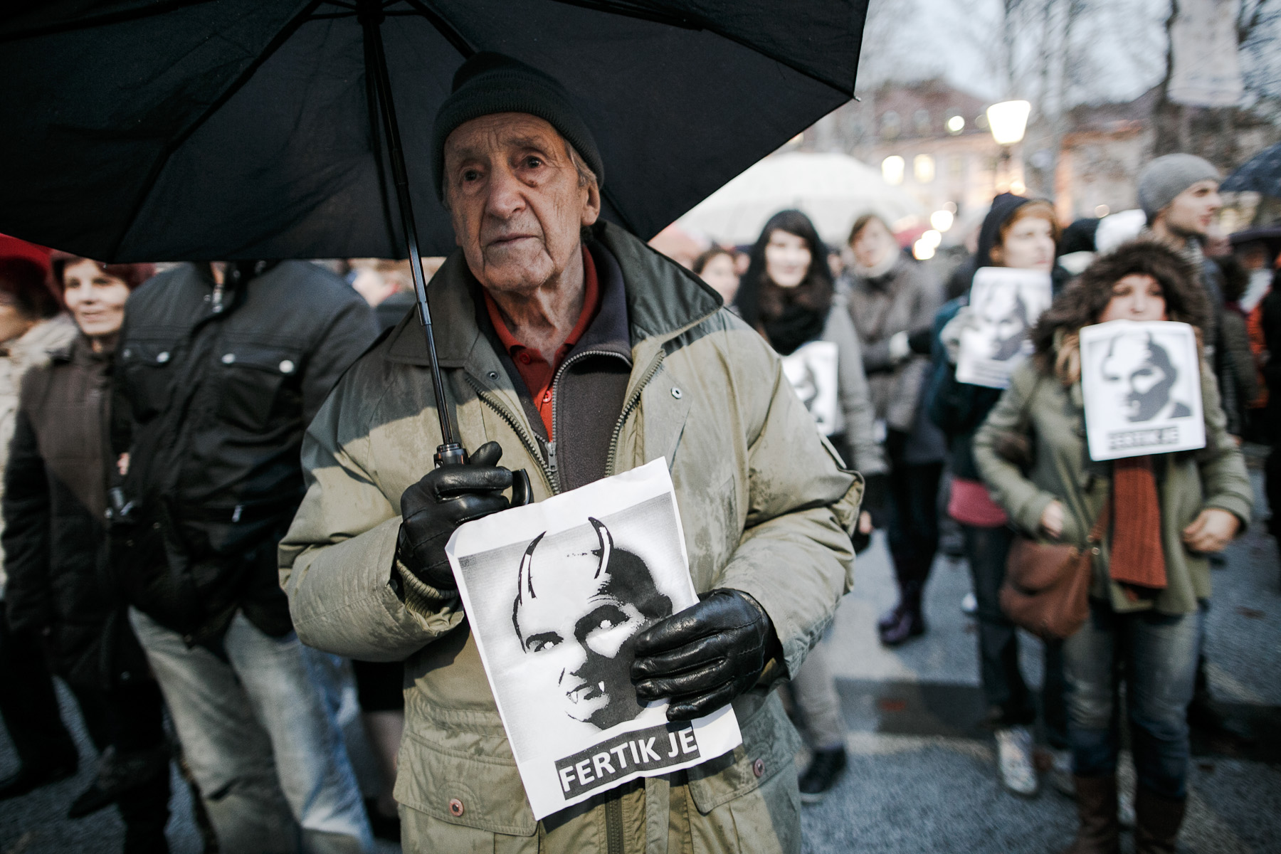 A protester carries a poster of prime minister Janez Jansa as the devil that reads {quote}He's done!{quote} during anti-government protests in Ljubljana, Slovenia.