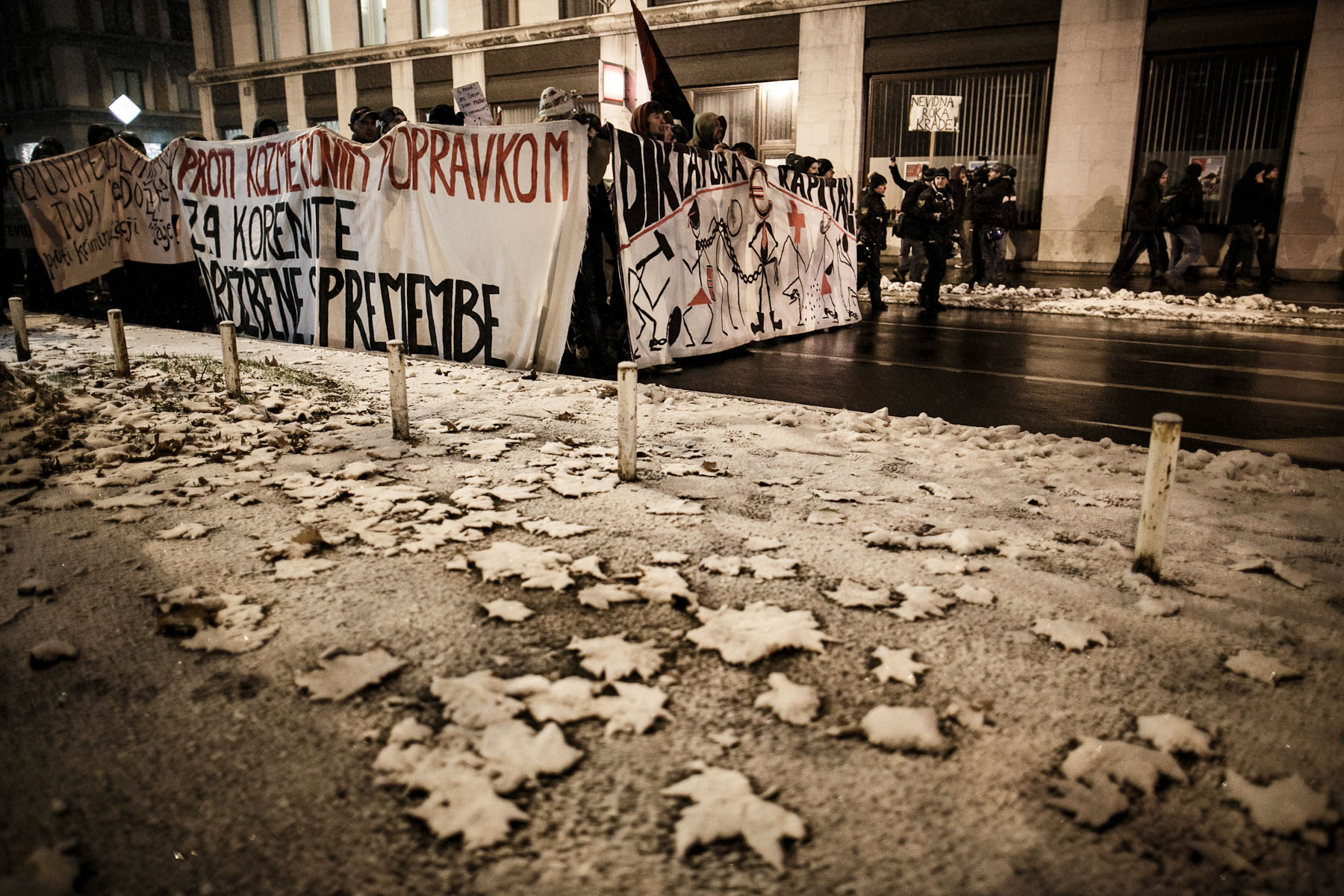 Protesters march through the streets during anti-government protests in Ljubljana, Slovenia, on December 7, 2012.