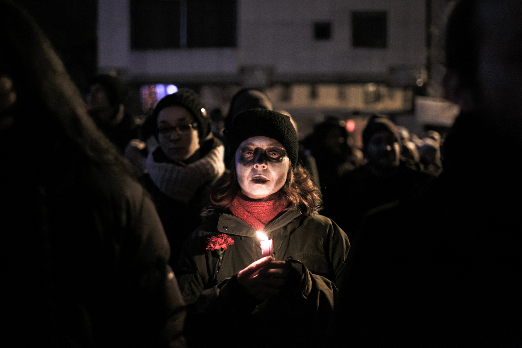 A protester in zombie makeup carries a carnation and a candle as signs of peaceful protest  during a protest staged by cultural workers on December 22, 2012, in Ljubljana, Slovenia.