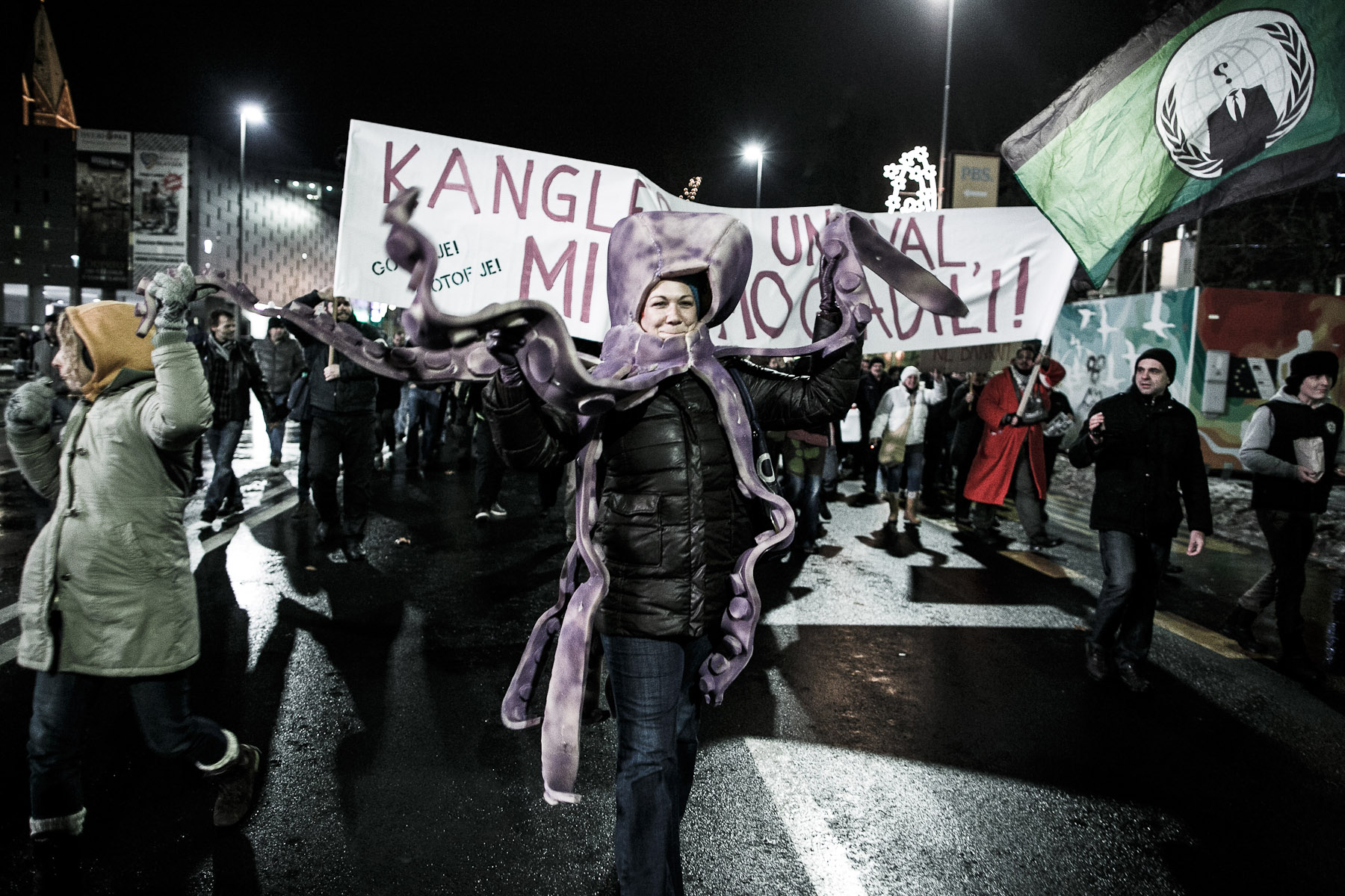 A protester wears an octopus mask referring to the system of local corruption during a protest march against the mayor and the local government in Maribor, Slovenia, on December 14, 2012.
