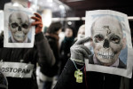Protesters wear paper masks of prime minister Janez Jansa as a skull during a protest staged by cultural workers in Ljubljana, Slovenia, on December 22, 2012.
