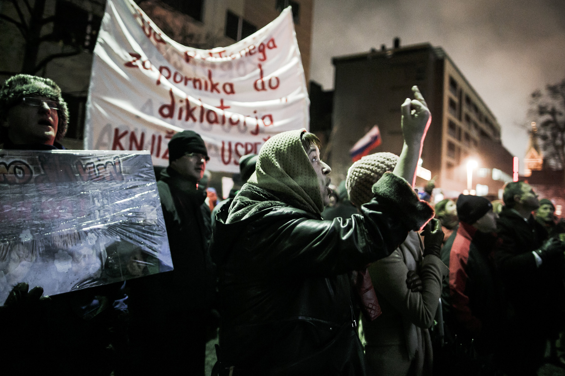 A protester gestures towards the municipality building during a protest against the local government and the city council in Maribor, Slovenia, on January 7, 2013.
