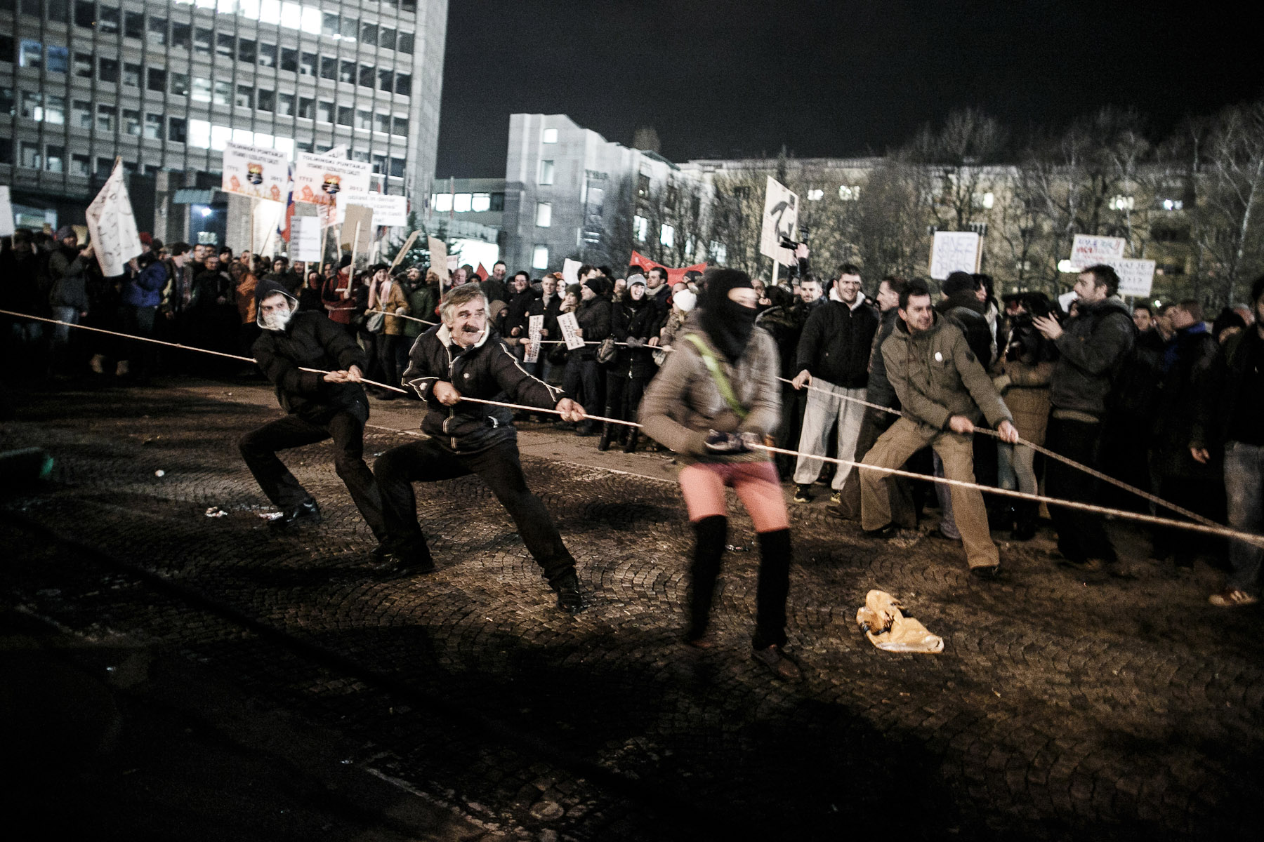 Protesters try to tear down the security fences in the Republic Square during the second countrywide uprising in Ljubljana, Slovenia, on January 11, 2013.