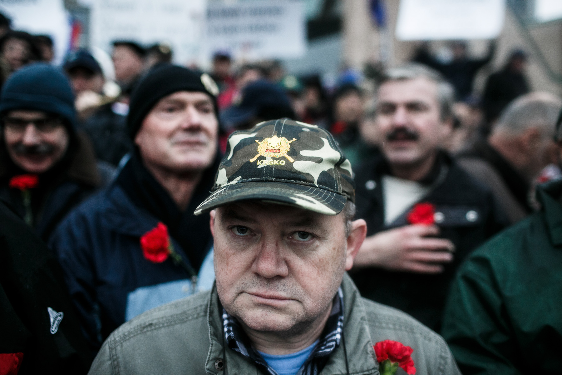 A war veteran wearing a veteran's cap and a carnation protests during a countrywide anti-government protest on December 21, 2012, in Ljubljana, Slovenia.
