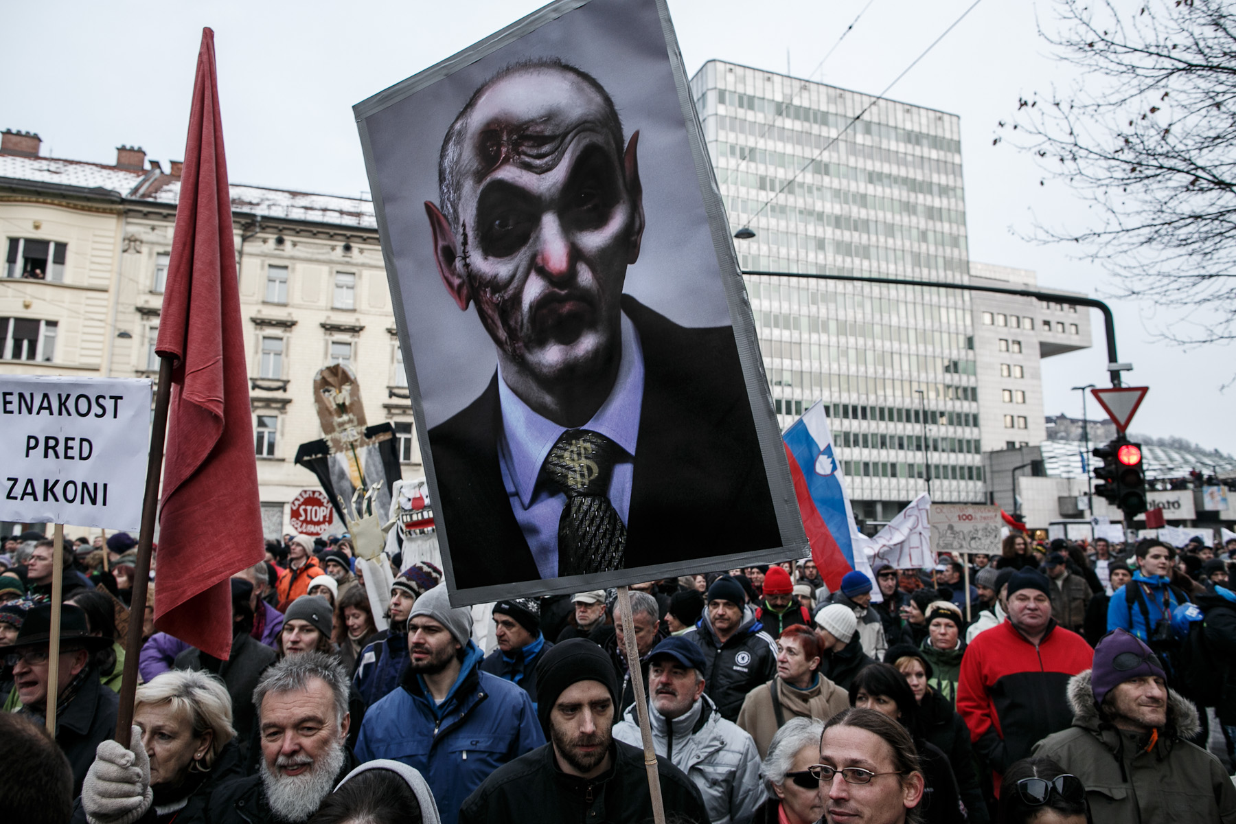 A protester carries a poster of prime minister Janez Jansa as a zombie during the third countrywide uprising against the government in Ljubljana, Slovenia, on February 8, 2013.