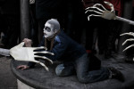 A protester wearing a zombie makeup holds the hand of a large skeleton effigy during a countrywide uprising in Ljubljana, Slovenia, on January 11, 2013.
