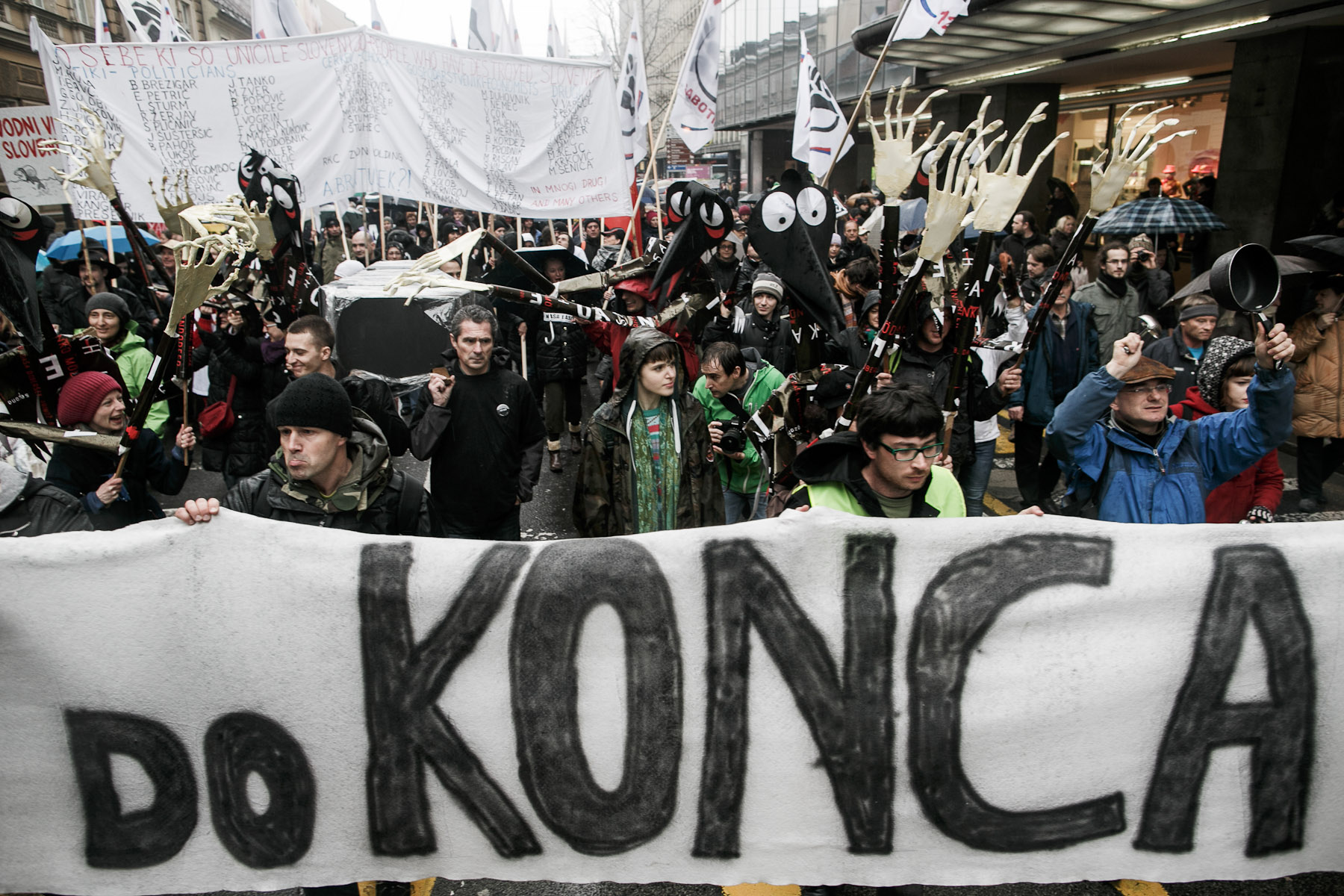 Protesters carrying a coffin to symbolically bury the state march in front of a banner that reads {quote}Till the end{quote} during the fourth country-wide uprising against the political elites in Ljubljana, Slovenia, on March 9, 2013.