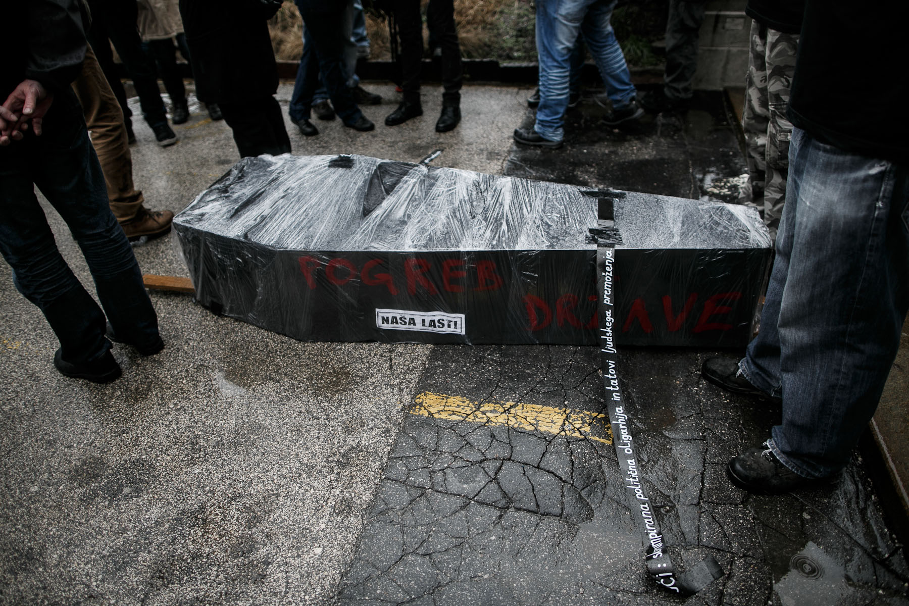 A coffin symbolizing a funeral of the state lies on the ground in front of the courthouse during the fourth country-wide uprising against the political elites in Ljubljana, Slovenia, on March 9, 2013.