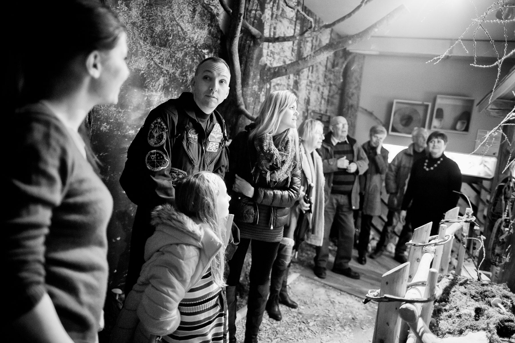 The Bresnik family and their relatives walk through an exhibition at the Rinka tourist information center in Solcava, Slovenia.