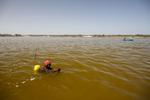 Salt gatherers, Lake Retba
