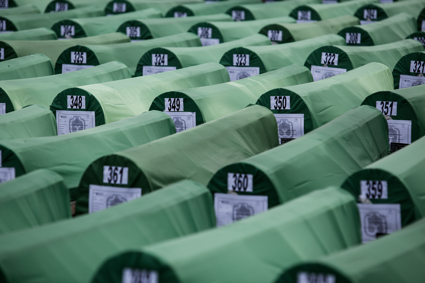 Lines of coffins at the Potocari cemetary before the mass burial of 775 newly identified victims of the 1995 Srebrenica massacre on July 11, 2010.