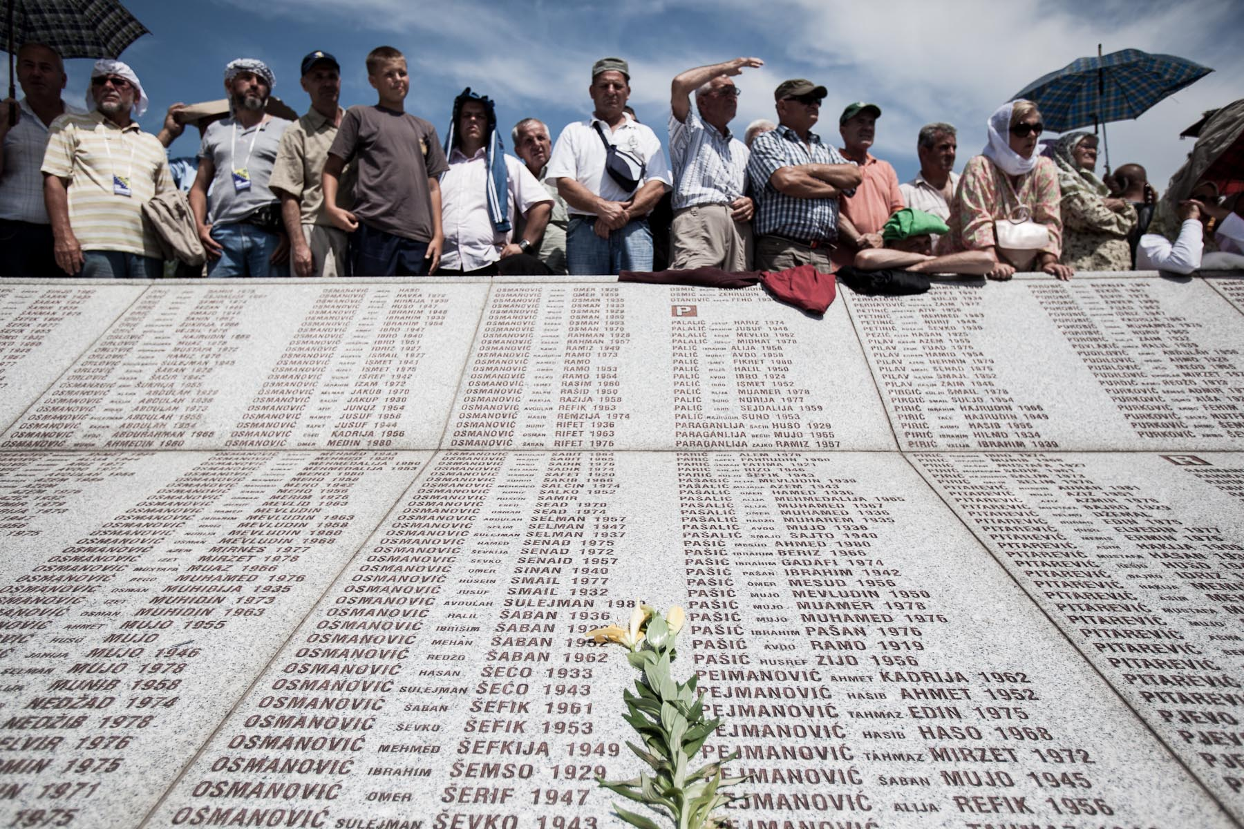 Crowds of people watch the memorial ceremony at the Potocari cemetery in Srebrenica before the mass burial of 775 newly identified victims of the 1995 Srebrenica massacre on July 11, 2010.