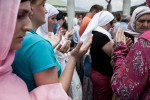 Thousands of people pray during the memorial ceremony at the Potocari cemetery in Srebrenica before the burial of 775 victims of the 1995 Srebrenica massacre on July 11, 2010.