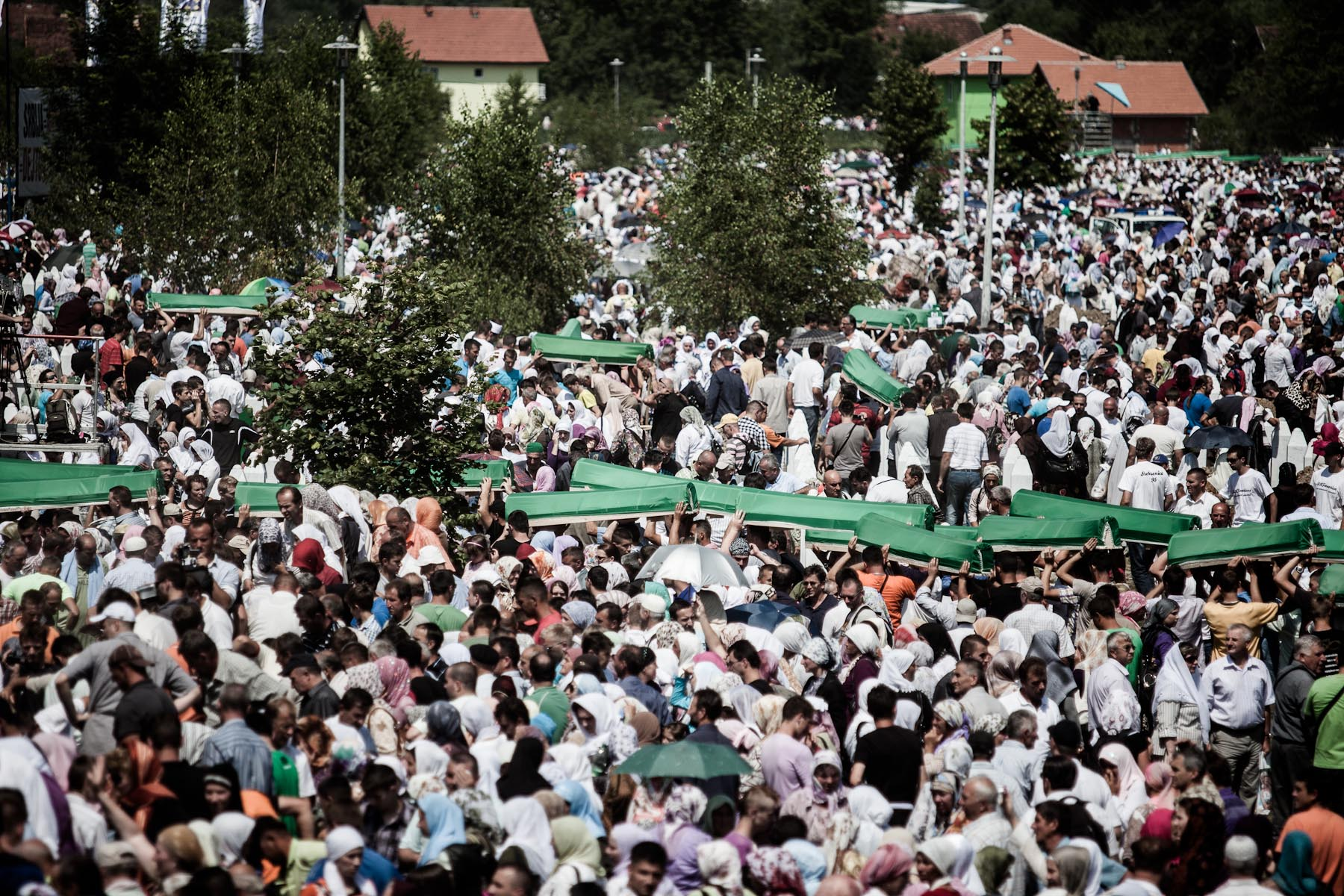 Coffins are taken to the graves during the mass burial of 775 newly identified victims of the 1995 Srebrenica massacre in Potocari cemetery, July 11, 2010.