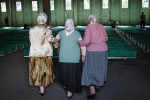 Bosnian women enter a hall full of coffins to search for their loved ones in the Potocari memorial center, Srebrenica, July 10, 2010.