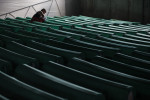 A man prays among rows of coffins at the Potocari memorial center, July 10, 2010.