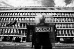 Riot police stand in front of the parliament building during anti-government student protests in Ljubljana, May 19, 2010.