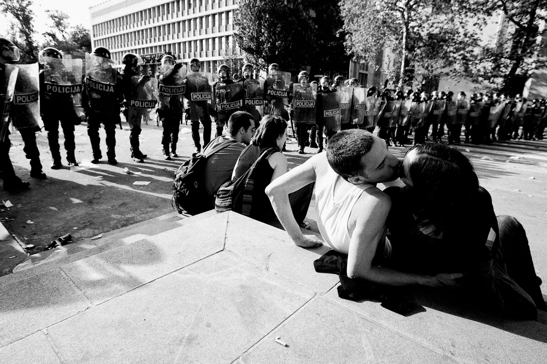 Students kiss to a backdrop of riot police on guard in front of the Slovenian parliament building after the anti-government student protests in Ljubljana, May 19, 2010.