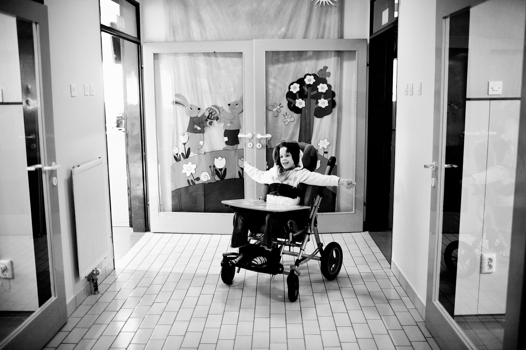 Barbara waits for her defectologist Nada Slana to take her to elementary school in Dornava where she joins first graders once a week. Dr. Marijan Borstnar rehabilitation institute in Dornava, Slovenia, April 5, 2012.