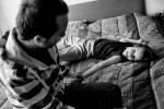 Barbara's brother Andrej holds her hand in their parent's bedroom in their home in Zavrc, Slovenia, April 7, 2012.