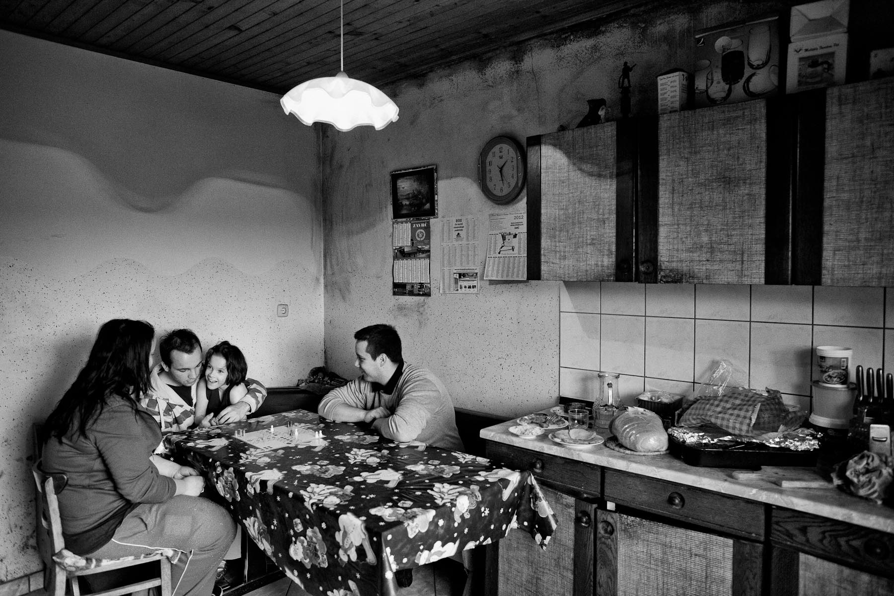 Barbara, her brother Andrej and Martin and her sister Petra play a board game in the kitchen of their home in Zavrc, Slovenia, April 7, 2012.
