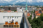 Trušnovec inspects the beehives on the roof of 1the 3-storey Hotel Park in the city centre of Ljubljana, the highest dwelling of bees in the city.