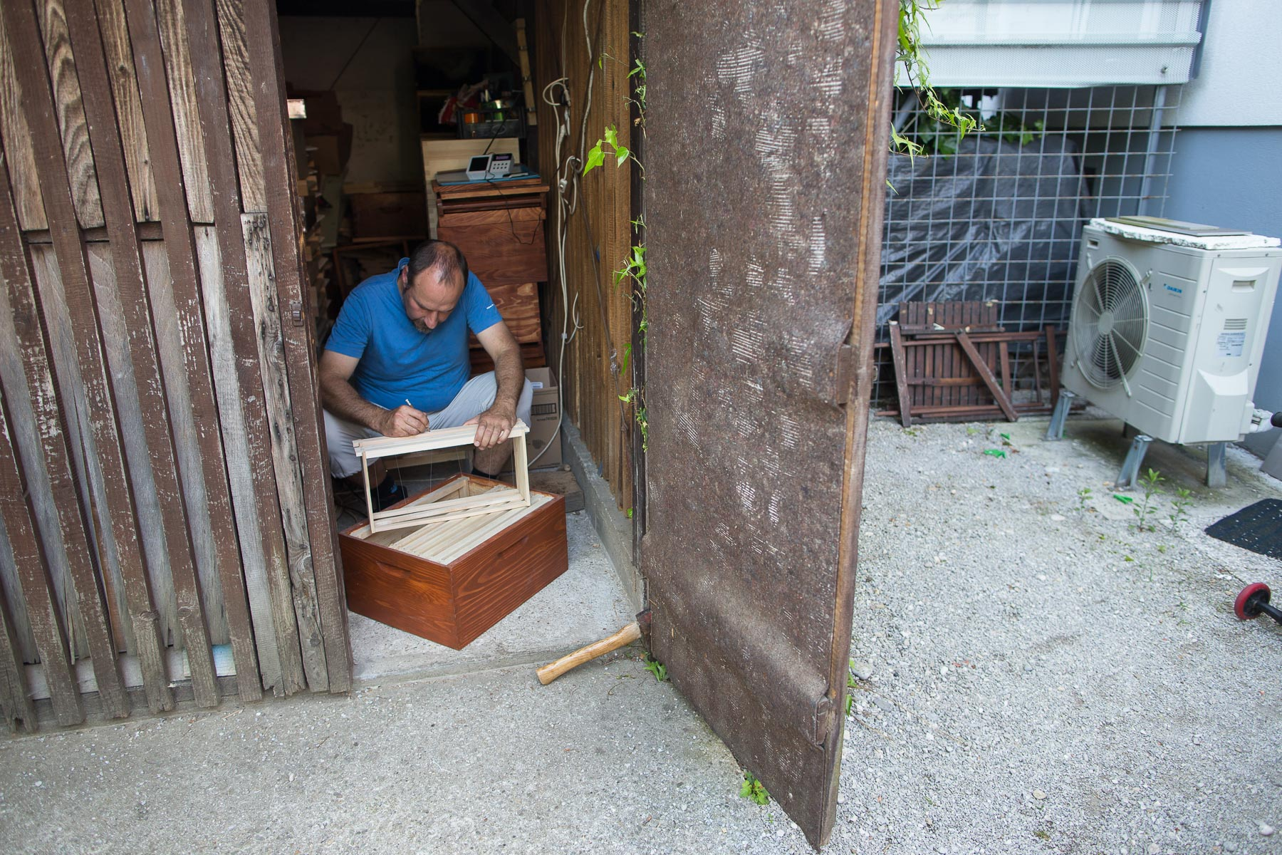 Trušnovec prepares hive frames in his shed at home. As part of his Rent-a-hive service, he needs to take care of all the rented beehives in the city. When bees are most active he must regularily add hives and frames to accomodate all the bees.