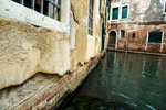 Damage to the facades of buildings in the city of Venice is caused by continuous wave action from boats and from natural causes, especially strong scirocco and bora winds, storms and of course frequent high tides. Flooding causes major structural damage to the foundations and the buildings in Venice. Tides carry away soil from the bottom and cause Venice to sink even faster in some places. Buildings are therefore structurally instable and several reconstruction works are underway.