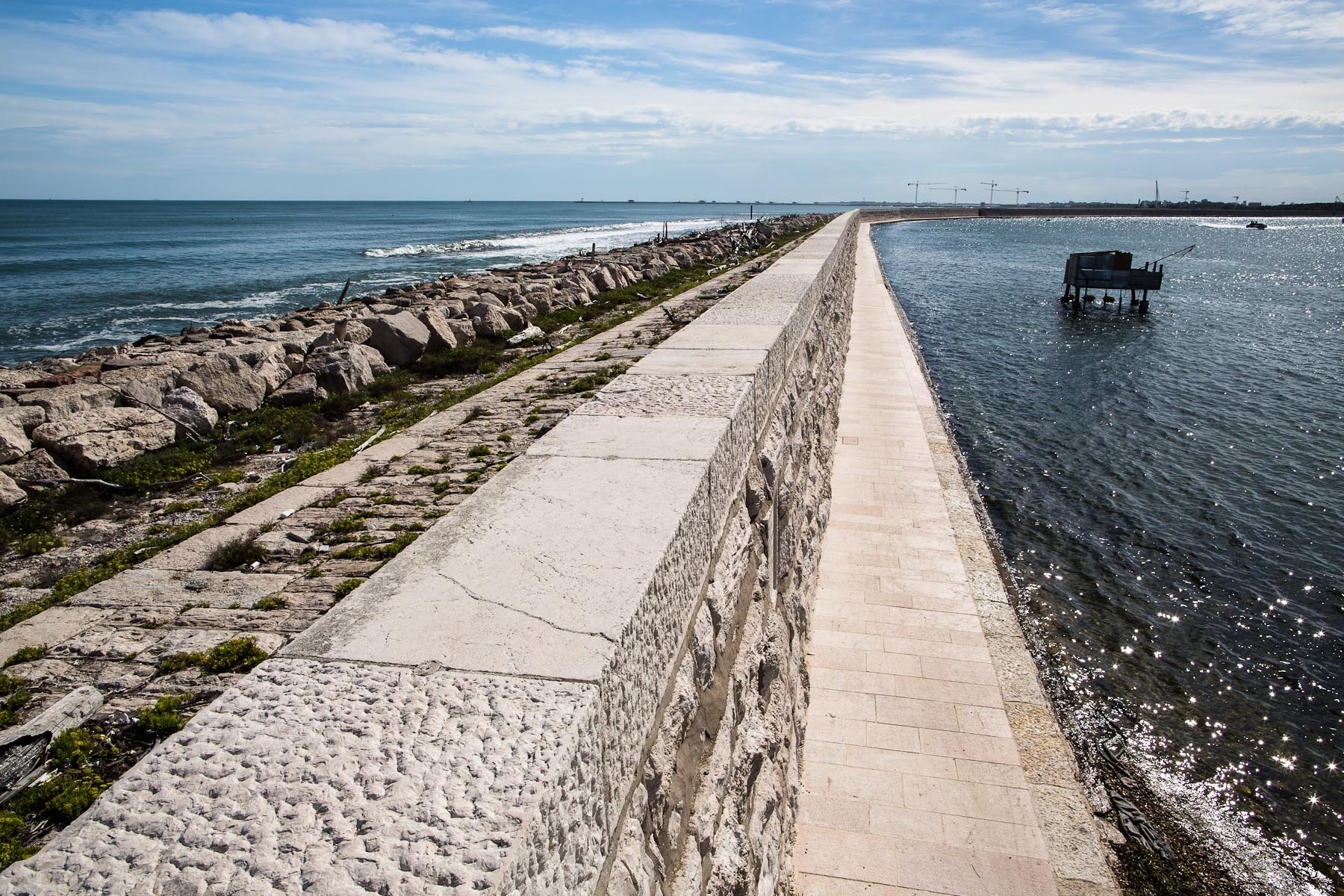 A strong high wall called the Murazzi stretches some 20 km along the barrier island of Pellestrina to protect the lagoon from open sea and the waves that come with storms. The wall was built over two hundred years ago and was restored in the 1970s.