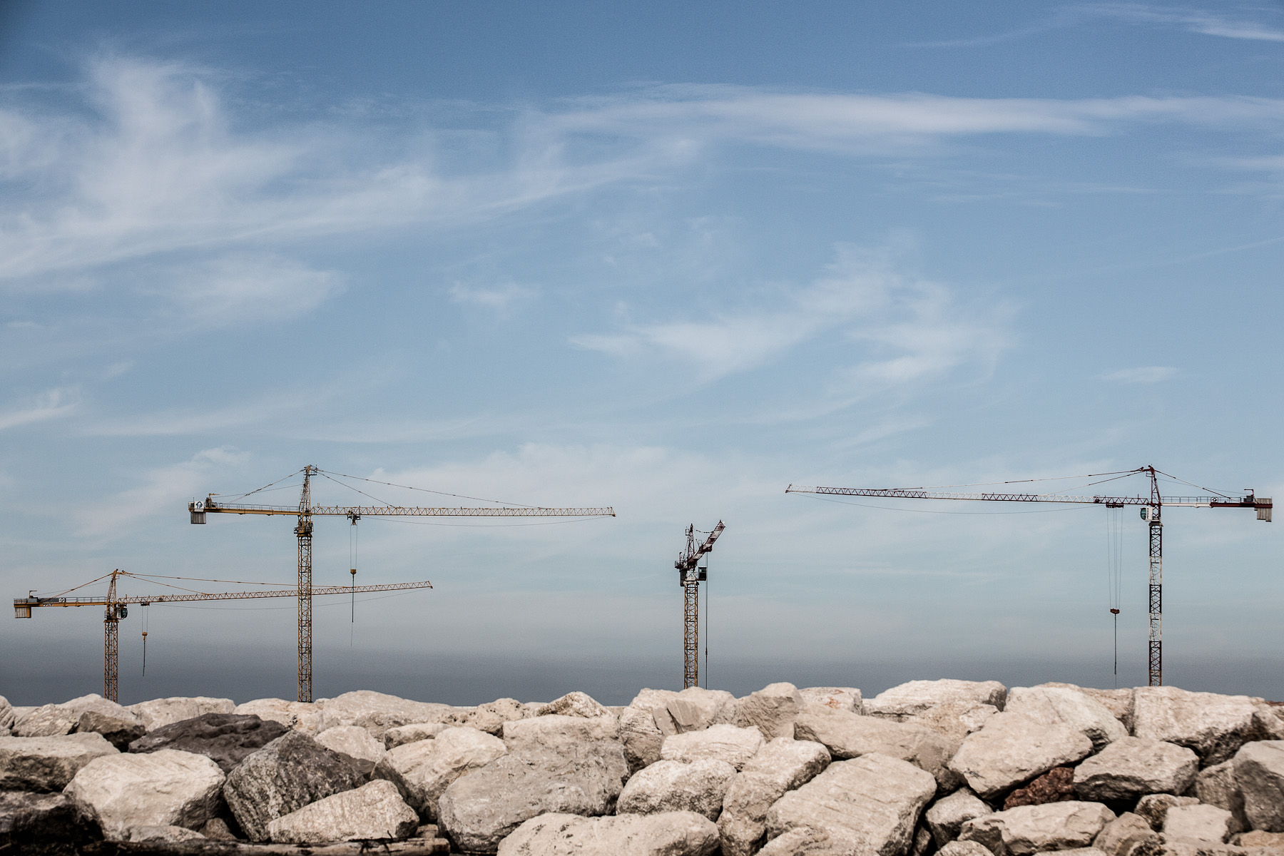 Construction cranes of the MOSE project are seen behind a wavebreak at Chioggia inlet on September 28, 2012. All inlets have been reinforced years ago.