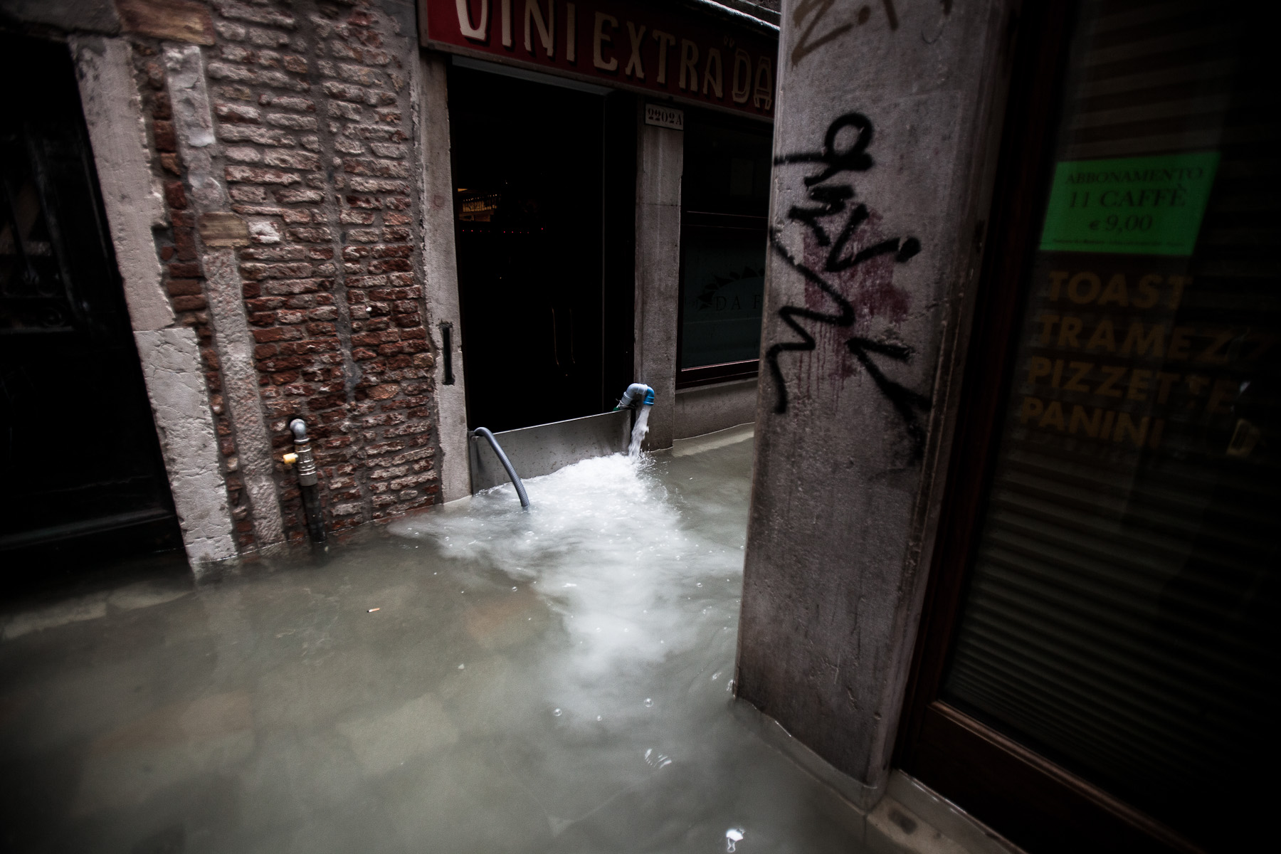 Floodwater is pumped out of a building in Venice during one of the highest floods in recent years on November 1, 2012. The city is sinking one to two milimeters a year, while the north lagoon is subsiding 2 to 3 mm a year and the islands in the south lagoon are sinking at a rate of 3 to 4 mm a year. This subsidence will have to be accounted for by the scientists trying to protect the lagoon.