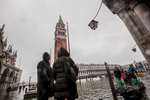 Tourists wade through high water in San Marco Square in Venice, November 1, 2012.