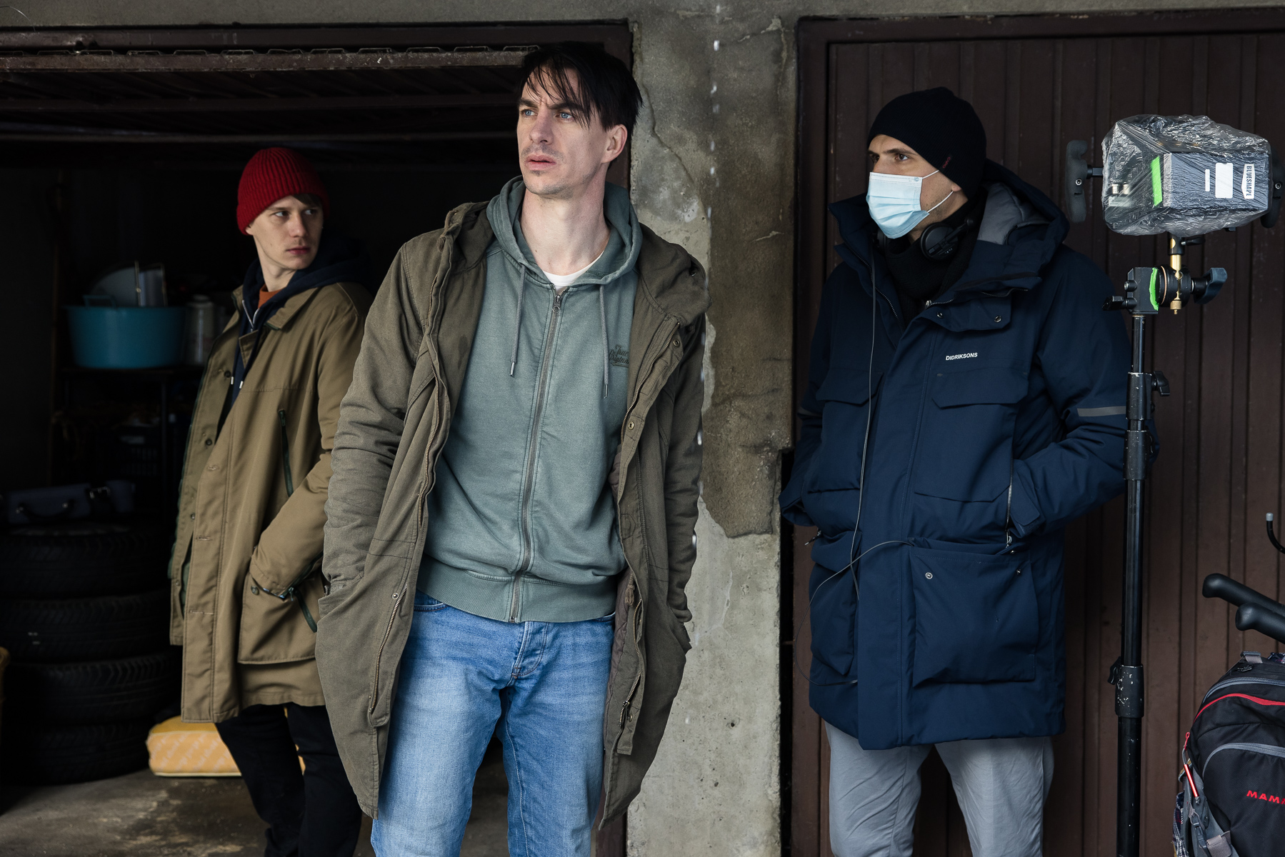 Actors Timon Šturbej and Jure Henigman with director Marko Šantić on the set of Wake Me.