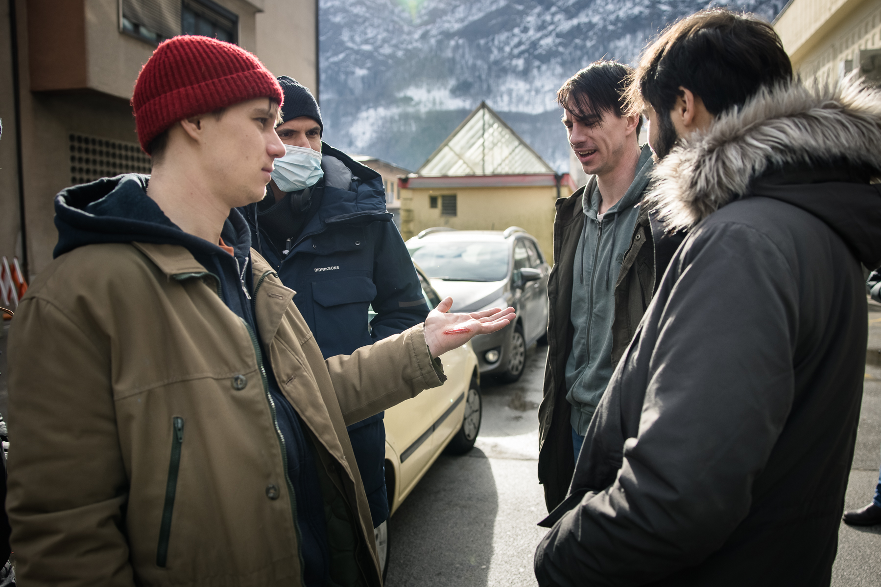 Actor Timon Šturbej showing special effects makeup to director Marko Šantić and actors Jure Henigman and Benjamin Krnetić on the set of Wake Me.