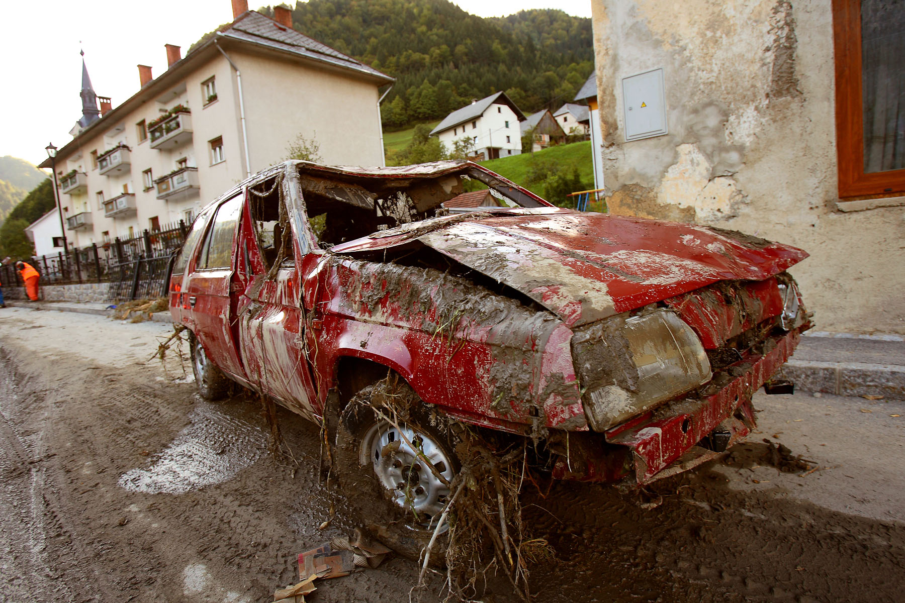 A demolished car on the main street of Železniki. The torrent carried with it huge ammouns of rocks, logs and debris that caused a lot of damage.
