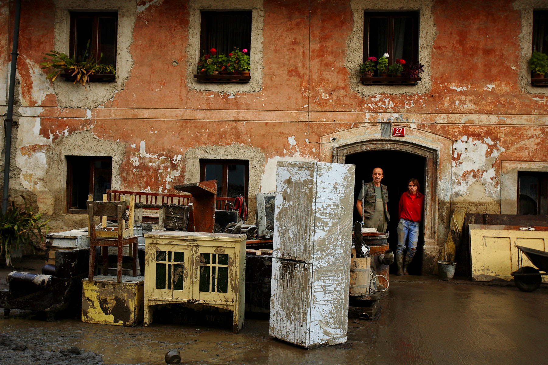 Citizens of Železniki clean up their houses after a devestating flash flood the day before.