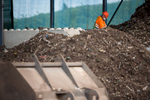 A worker inspects composting bio waste  at the RCERO Ljubljana recovery plant.