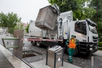 Early in the morning, waste collectors go out in special garbage trucks to empty underground containers.